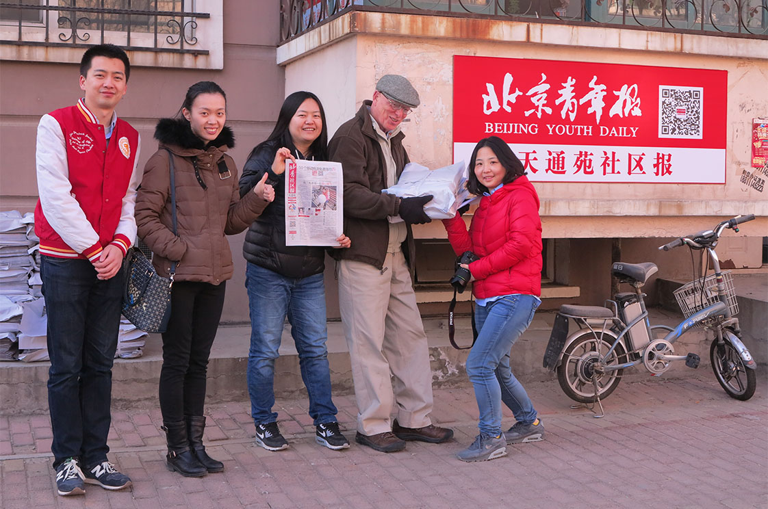 Some of the staff of the Tian Tong Yuan newspaper on delivery day, joined by Mr Joke. (Photo by Chen Kai)