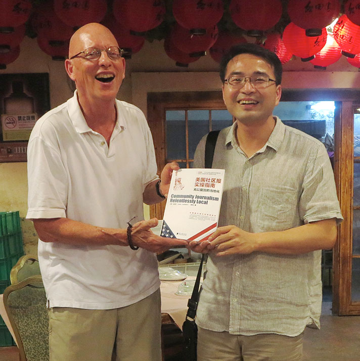 The author is joined by his editor, Mr. Ruan, at the moment the new book is unveiled for the first time. Are we happy campers or what? (Photo by Chen Kai)