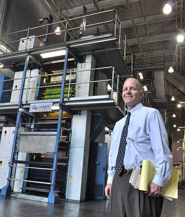 Publisher Charles Broadwell and the humongous modern press at the Fayetteville Observer. (Jock Lauterer photo)