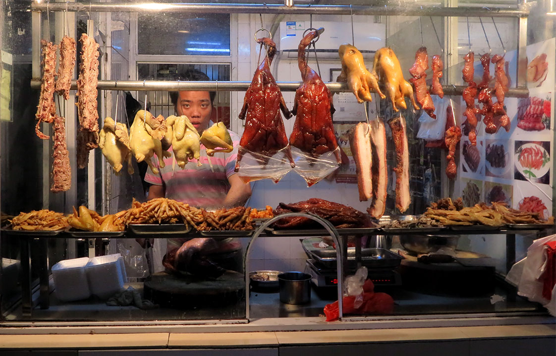 At a Guangzhou open-air market a butcher prepares his wares. (Jock Lauterer photo)