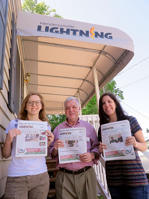 Editor Moss is bracketed by his two summer intern-stringers, Emily Stanley, left, of Davidson; and Marissa Treible, right, of UNC-Chapel Hill. (Jock Lauterer photo)