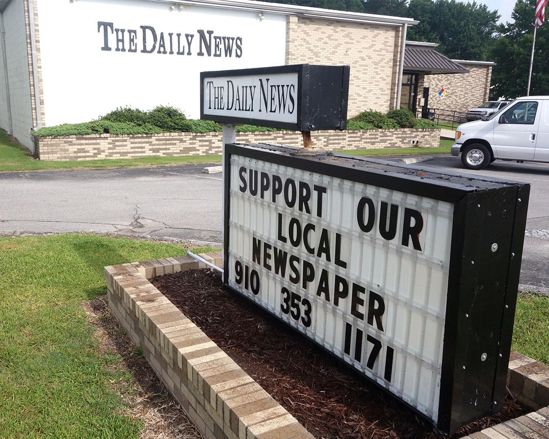 Located far from downtown in an industrial section of town, the paper office features a public appeal. (Jock Lauterer photo)