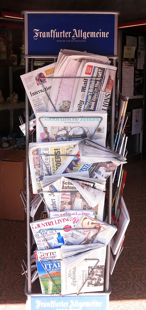 In addition to about a dozen Italian newspapers, the local news stand carries papers from across Europe. (Jock Lauterer photo)